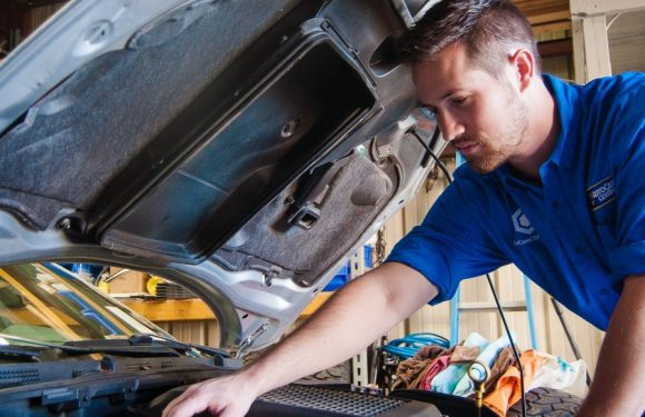 The Job Of A Car Mechanic In A Car Repairing Center